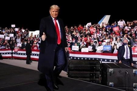 As more Americans vote early, Trump presses on to Iowa