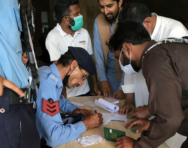 Desperate expatriate workers storm Islamabad vaccination centre