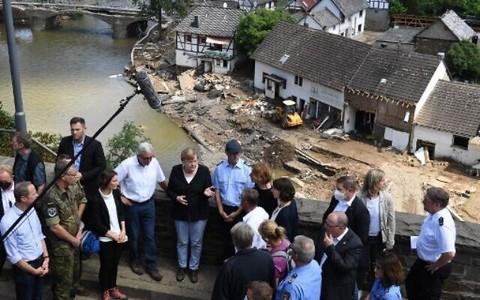 Merkel sees 'surreal' wreckage as Europe flood death toll tops 180