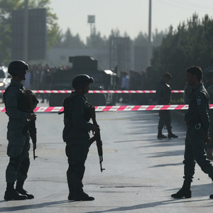 Police guard killed at UN compound as fighting rages for Afghan city