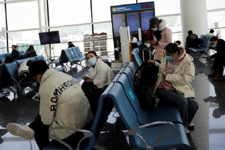 China restricts overseas travel to curb Covid outbreak