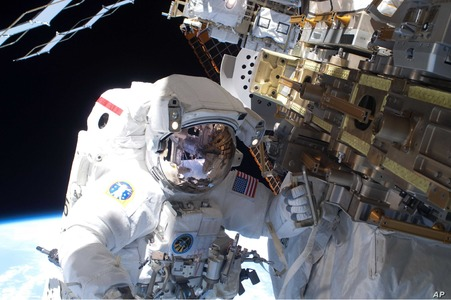 China's astronauts make spacewalk to upgrade robotic arm
