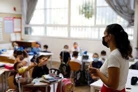 Israeli students return to school amid surge in Covid  cases