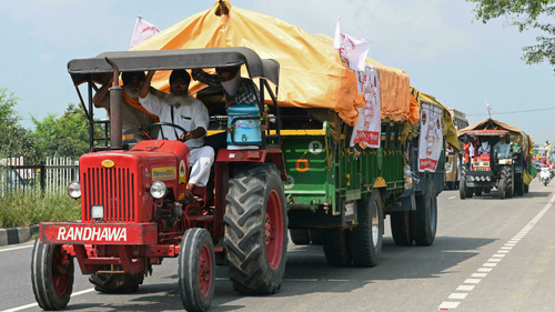 Tens of thousands of farmers vow defiance over India laws