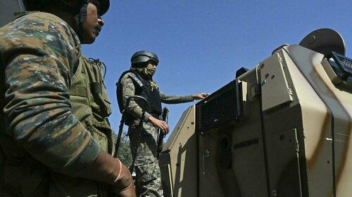 Hundreds detained in Indian Kashmir after teachers shot dead