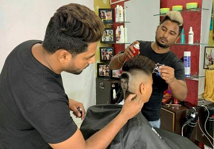 Indian barber siblings turn heads into canvasses by giving unusual haircuts