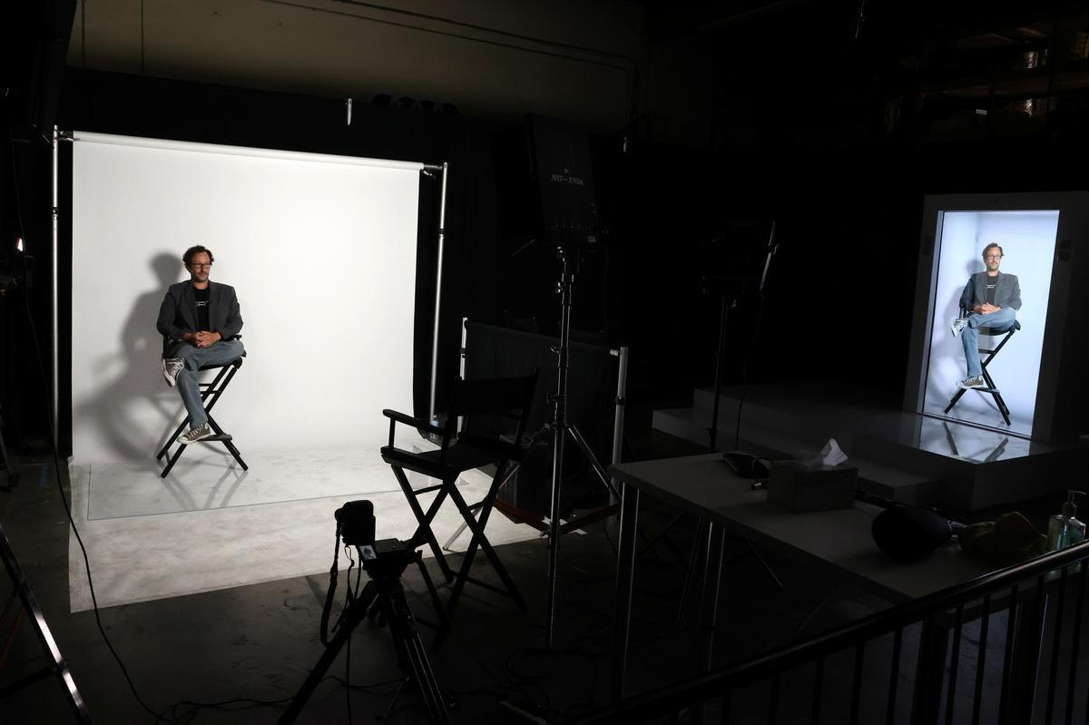 Portl inventor David Nussbaum is shown with an A.I.-powered life-size hologram of himself in Gardena, near Los Angeles, California, U.S., August 3, 2020. REUTERS