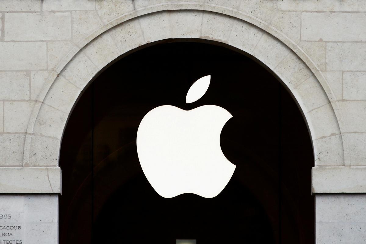 FILE PHOTO: Apple logo is seen on the Apple store at The Marche Saint Germain in Paris, France July 15, 2020. REUTERS