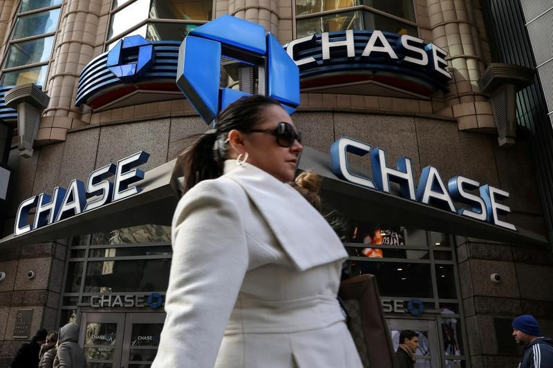 FILE PHOTO: A woman passes by a JPMorgan Chase bank in Times Square in New York City, U.S., March 7, 2019. REUTERS