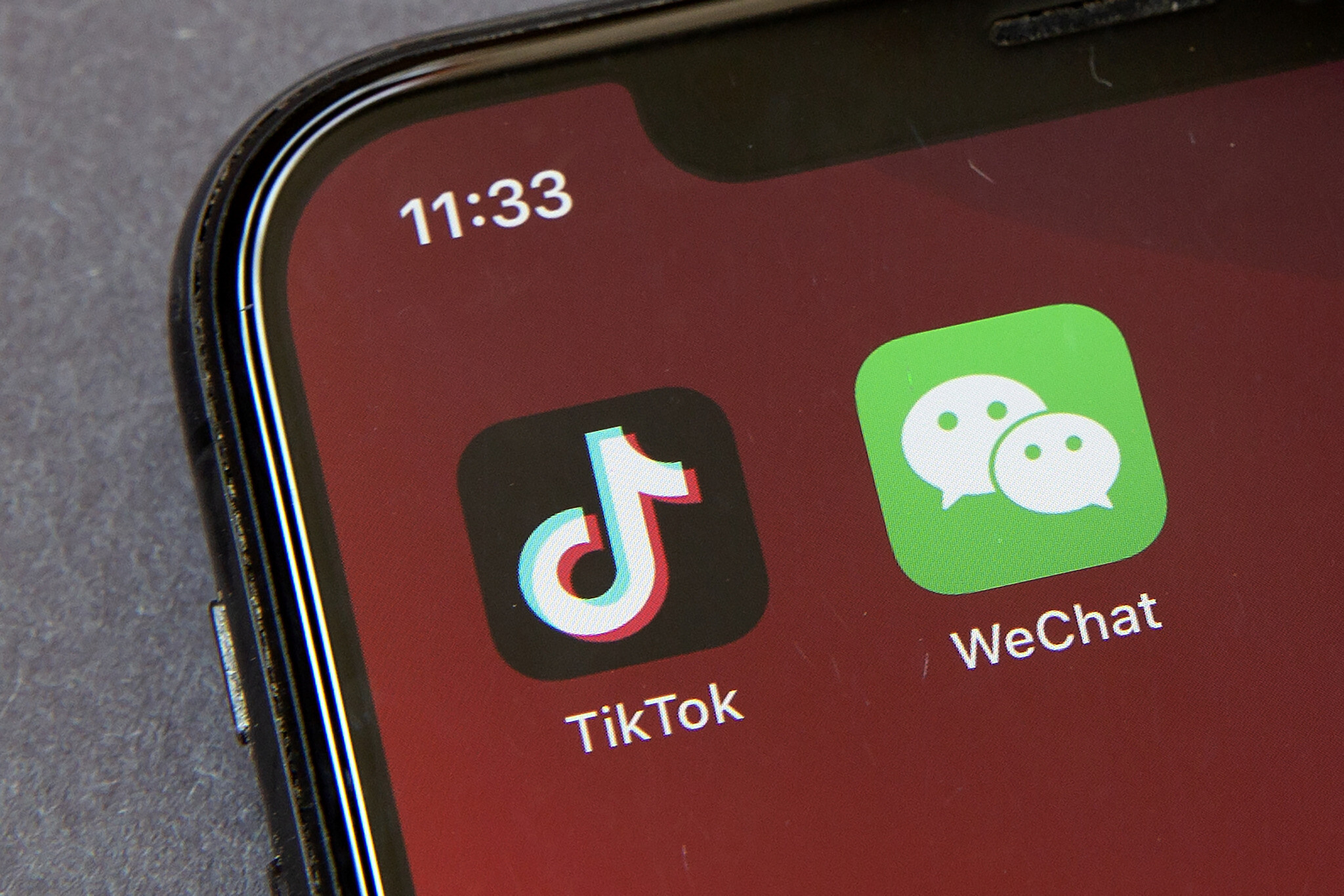 Icons for the smartphone apps TikTok and WeChat are seen on a smartphone screen in Beijing.