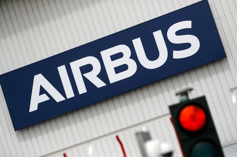 FILE PHOTO: The logo of Airbus is pictured at the entrance of the Airbus facility in Bouguenais, near Nantes, France, July 2, 2020. REUTERS