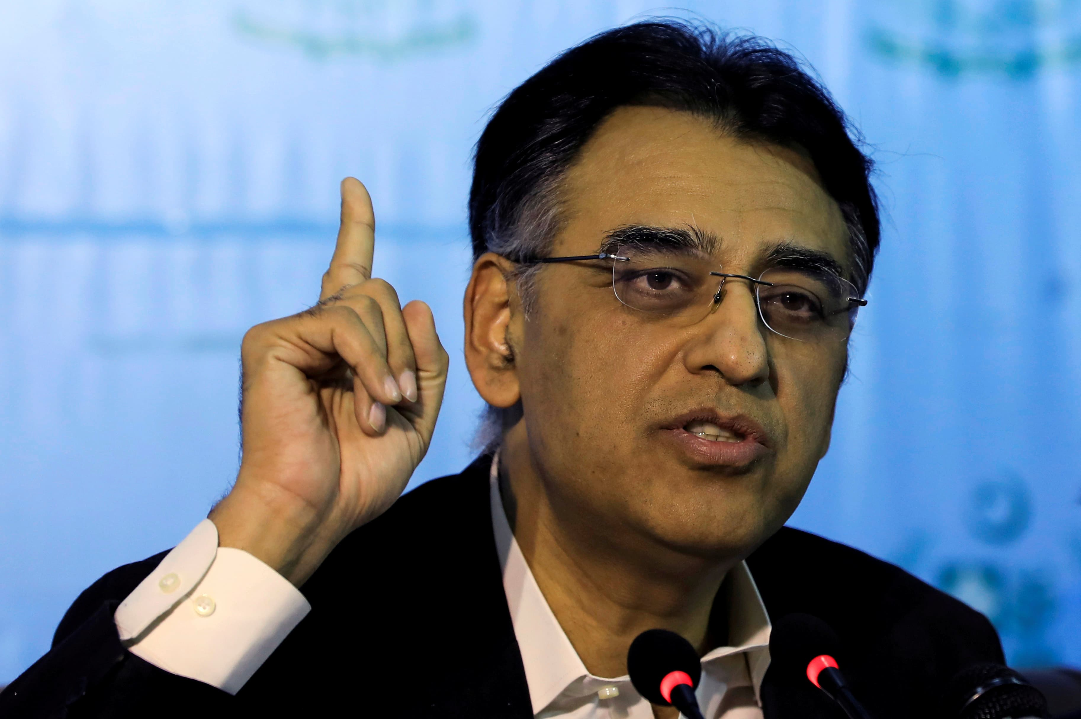 Asad Umar criticised Shehbaz Sharif for holding rallies in the middle of the pandemic. (Reuters)