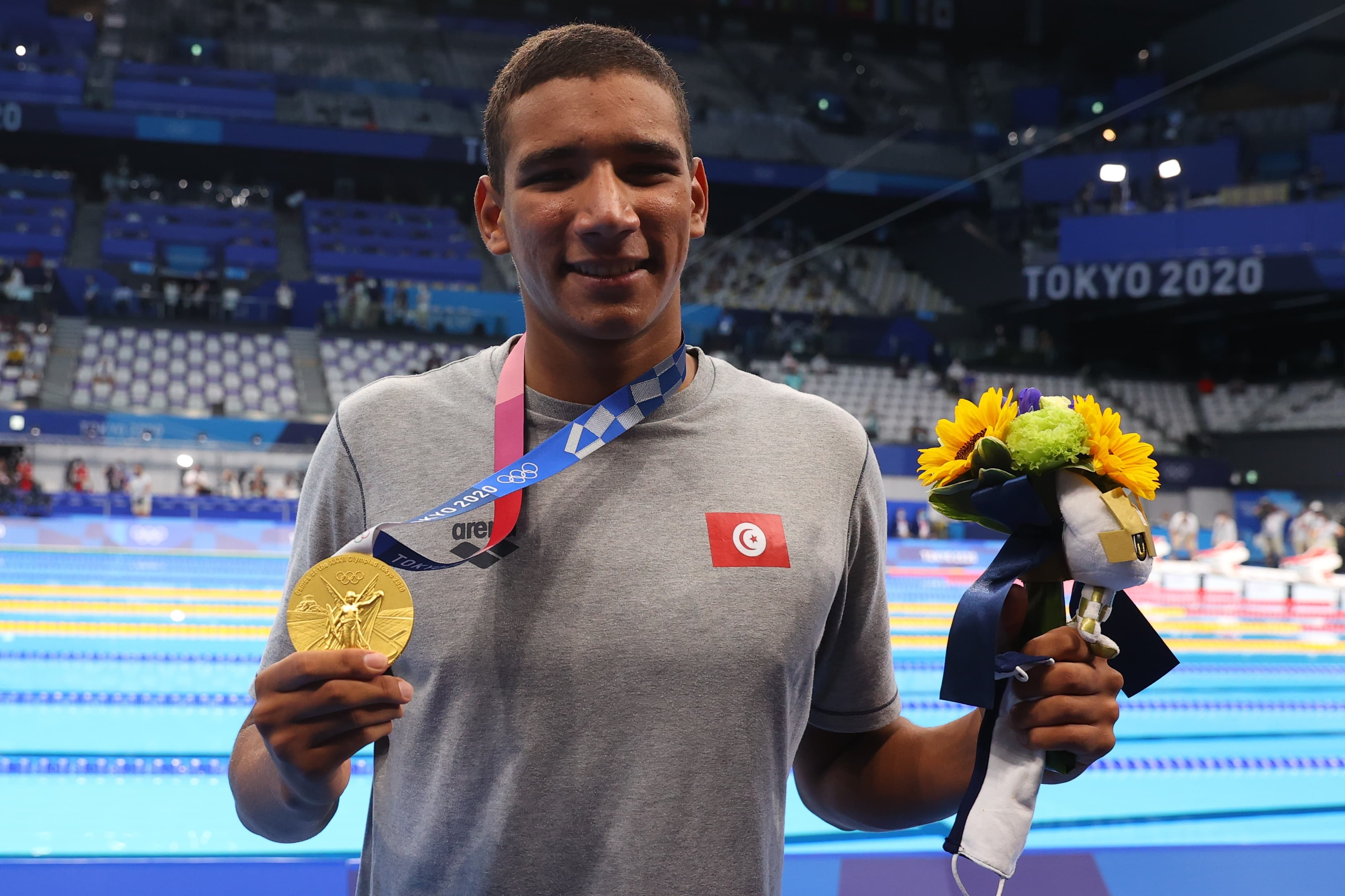 18-year-old Ahmed Hafnaoui stunned the swimming superpowers with victory in the men's 400m freestyle. Reuters