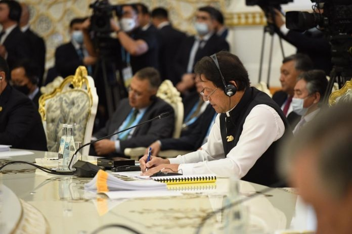 PM Imran Khan said addressing the threats to international and regional peace and security was a vital interest for SCO. APP