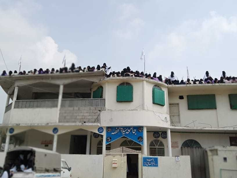 Hundreds of women clad in burka gathered on the roof top of the seminary where the flag was hoisted. Roohan Ahmed Twitter