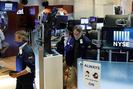 Shares rise on upbeat data but COVID-19 spike dampens sentiment