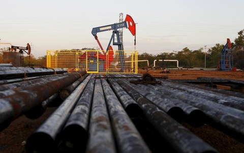 Oil slips to $45 on demand concerns, set for weekly rise