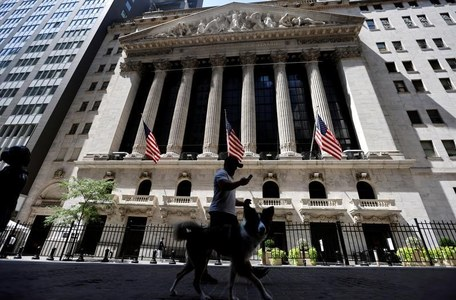 Wall Street rises at open on M&A activity, vaccine hopes