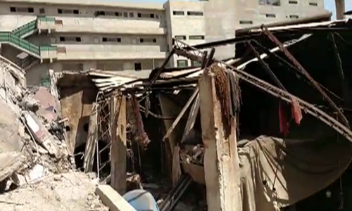 At least 4 injured, many feared trapped as a factory collapses in Karachi