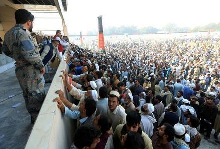 Afghans jostling for visas sparks stampede, killing at least 15
