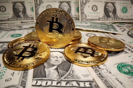 Dollar buoyed by U.S. recovery hopes, bitcoin near record $52,640