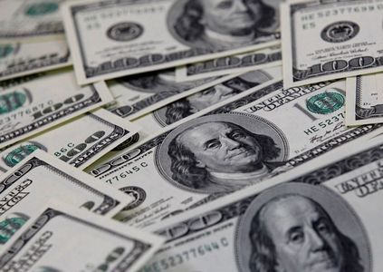 Dollar at one-week lows after benign inflation data
