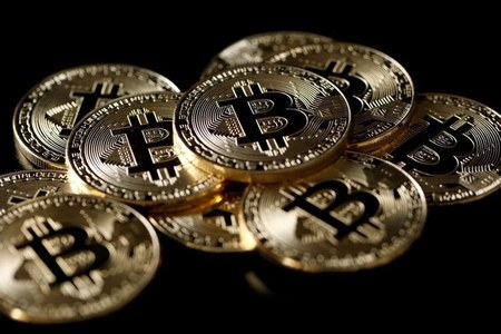 Bitcoin takes breather after retreat from record near $62,000
