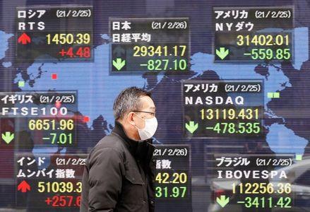 World stocks hit record high as bond yields ease