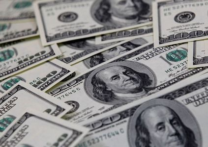 Dollar pinned near one-month low amid subdued U.S yields