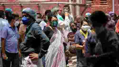 India's virus cases lower but WHO expert says positive tests ominously high