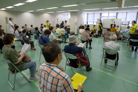 Japan opens mass vaccination sites for elderly ahead of Olympics