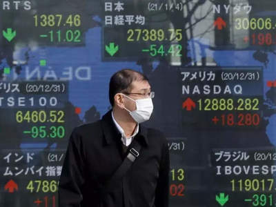 Asian shares up, dollar wallows as Fed soothes inflation fears