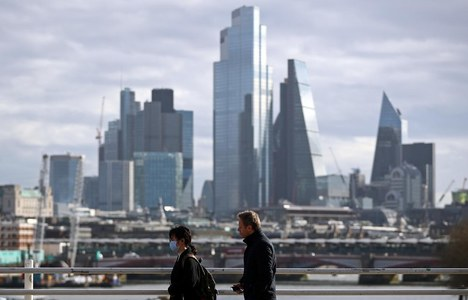 UK recovery quickens in April as economy posts record annual jump