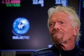Branson aims to make space trip on July 11, ahead of Bezos
