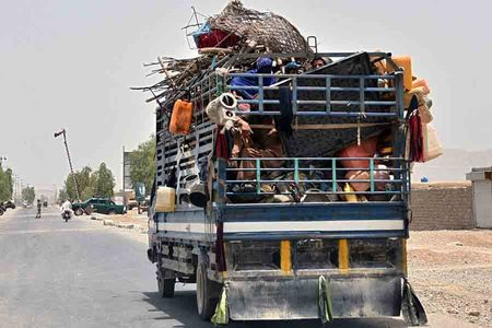 Scores flee as Taliban tighten noose around western Afghan city
