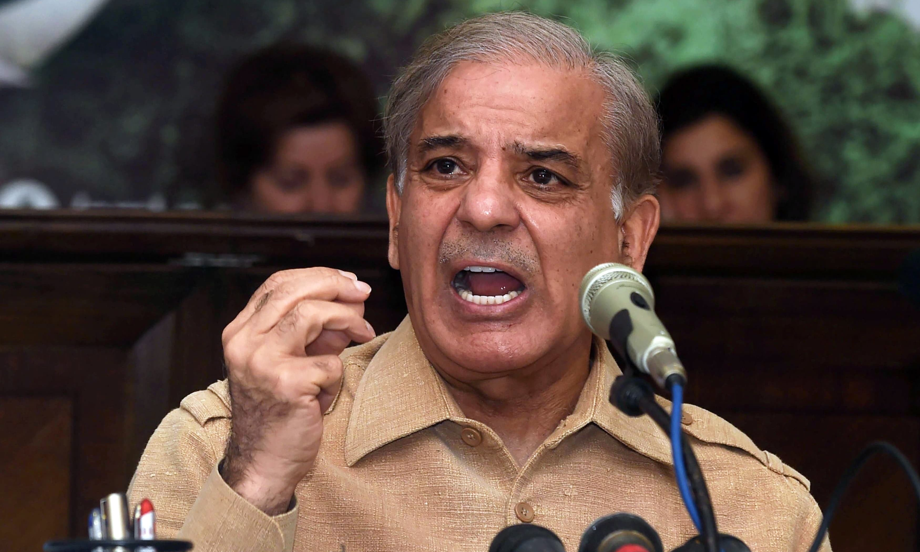 Shahbaz Sharif, brother of ousted Pakistani prime minister Nawaz Sharif, and head of the Pakistan Muslim League-Nawaz (PML-N), addresses a press conference after his brother's sentencing, in Lahore on July 6, 2018. Pakistan's former prime minister Nawaz Sharif was sentenced in absentia to 10 years in prison by a corruption court in Islamabad on July 6, lawyers said, dealing a serious blow to his party's troubled campaign ahead of July 25 elections.  / AFP PHOTO / ARIF ALI — AFP or licensors