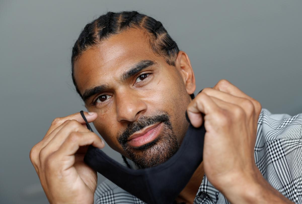 Former boxing heavyweight world champion David Haye poses for a photograph following the launch of his premium range of high-tech face masks, ahead of the British Government's law on wearing face masks in shops coming into effect on Friday 24th July, amid the coronavirus disease (COVID-19) outbreak, in London, Britain, July 23, 2020. REUTERS