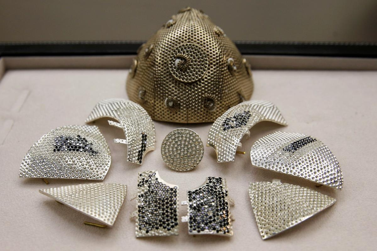 Parts of a diamond encrusted gold coronavirus disease (COVID-19) face mask, is seen in a fine jewelry factory in Motza, Israel August 11, 2020. Picture taken August 11, 2020. REUTERS