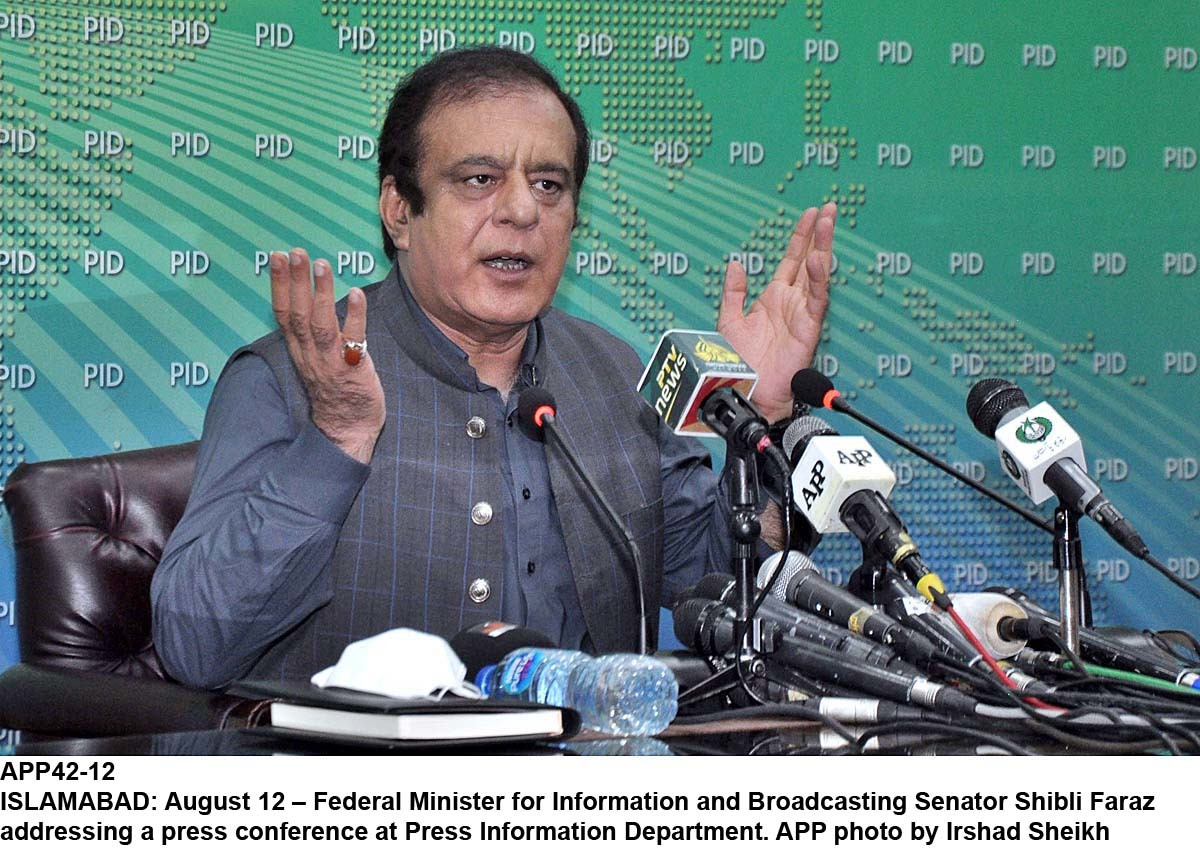 APP42-12 ISLAMABAD: August 12 – Federal Minister for Information and Broadcasting Senator Shibli Faraz addressing a press conference at Press Information Department. APP photo by Irshad Sheikh