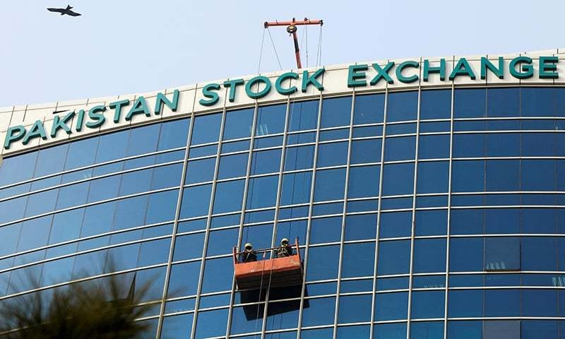 FILE PHOTO: Workers clean a glass facade of the Pakistan Stock Exchange (PSX) building in Islamabad, Pakistan December 3, 2018. REUTERS/Faisal Mahmood/File Photo