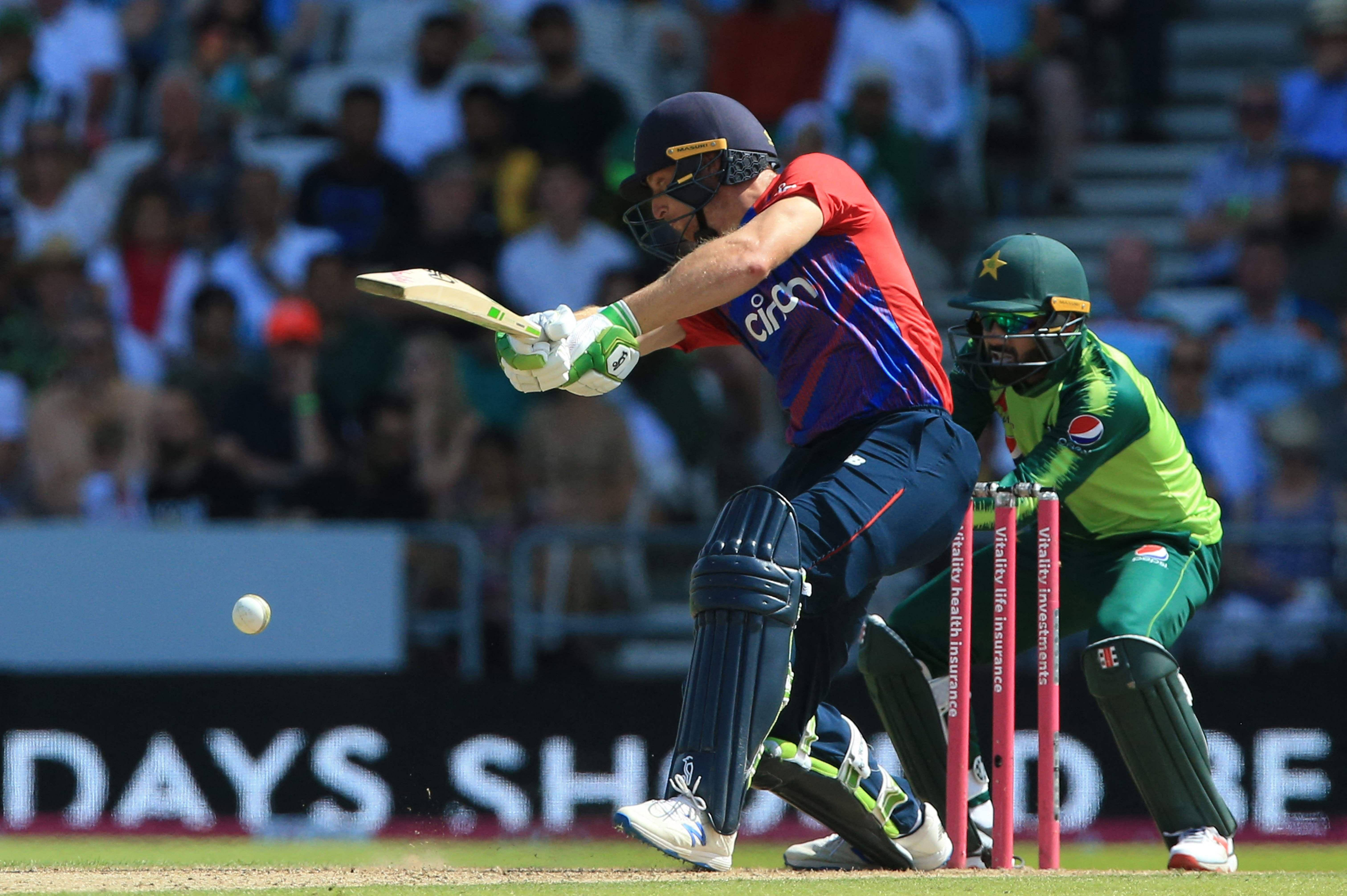 Jos Buttler hits a shot during the second T20 international against Pakistan. — AFP Photo