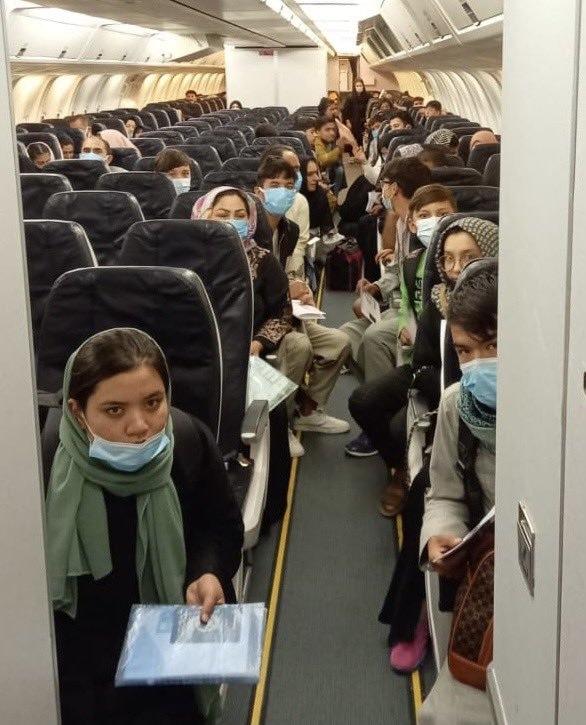 The right-wing radio host Glenn Beck shared an image of Afghans on a flight leaving Mazar-i-Sharif. TWITTER