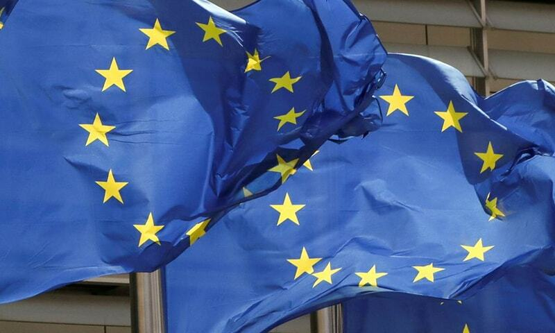 European Union flags flutter outside the EU Commission headquarters in Brussels, Belgium in this file photo. Reuters Photo